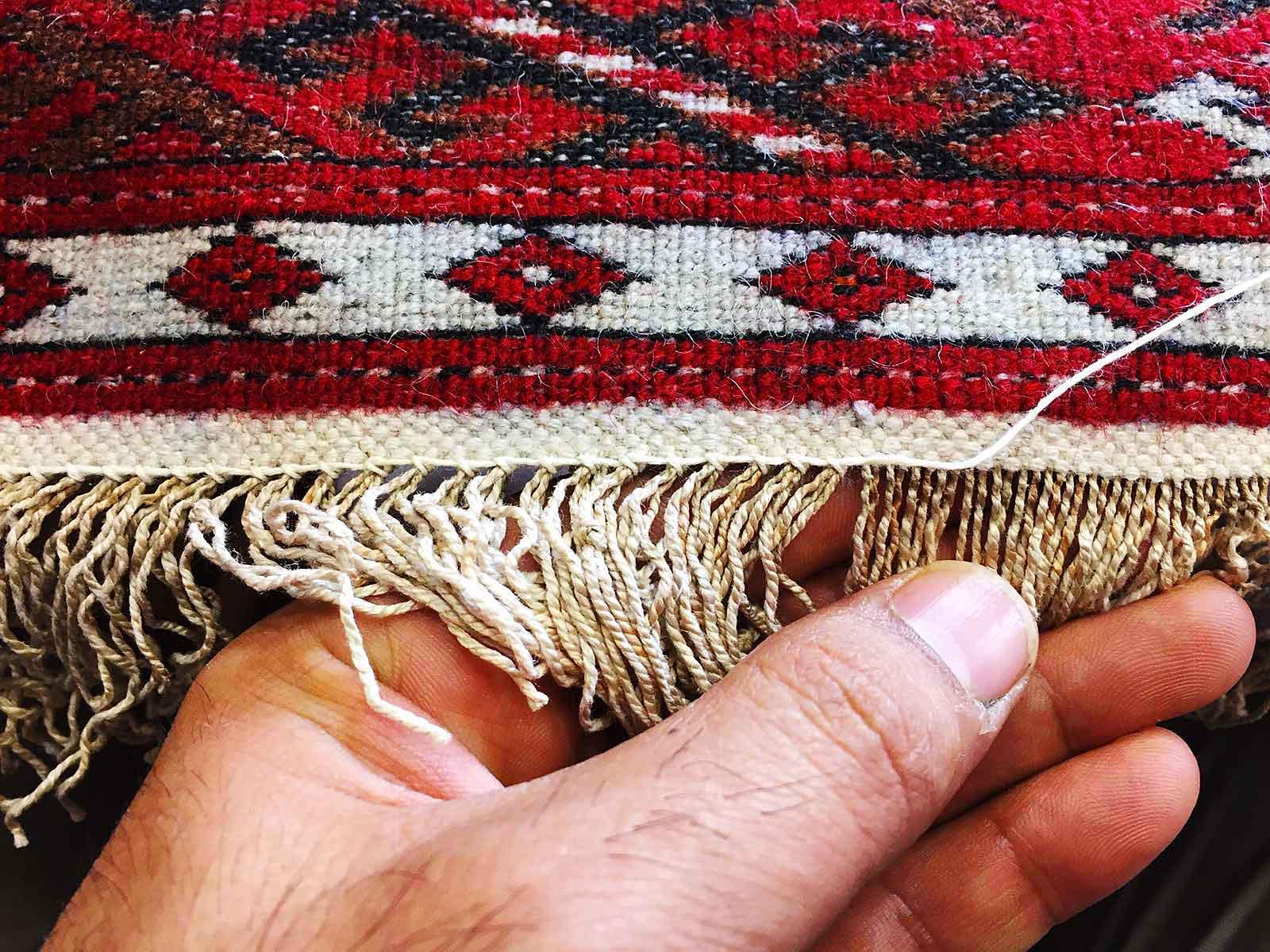 Rifacimento frange tappeto persiano a Milano